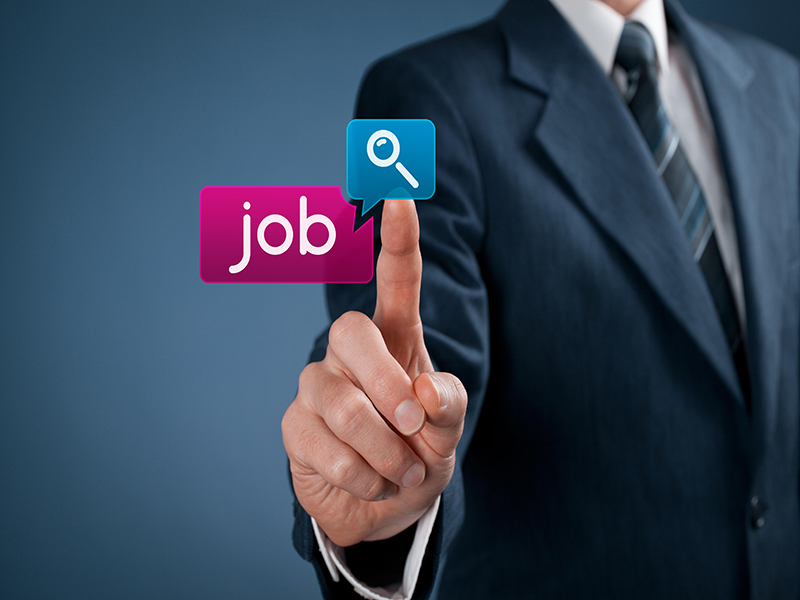 Job seeking concept. Businessman click on magnifying glass icon and job button.